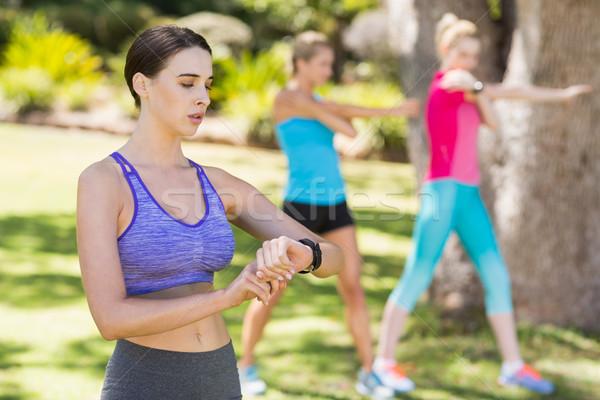 Woman checking time while exercising  Stock photo © wavebreak_media