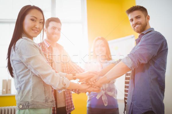 Portrait of smiling business people stacking hands Stock photo © wavebreak_media