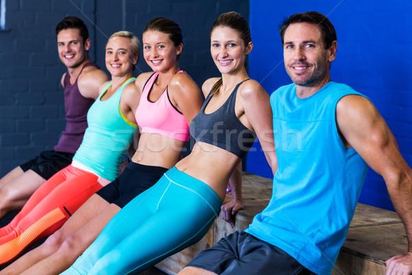 Happy athletes exercising on wooden box  Stock photo © wavebreak_media
