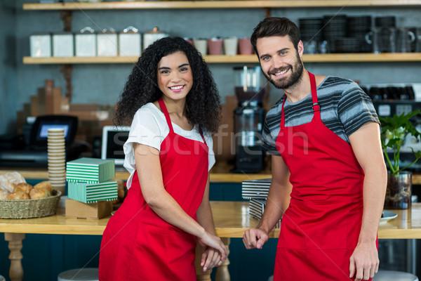 Portrait of smiling waiter and waitress leaning at counter Stock photo © wavebreak_media