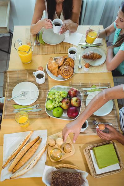 Overhead view of family sitting at breakfast table Stock photo © wavebreak_media