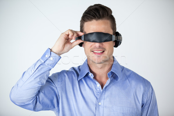 Homem virtual vídeo óculos branco diversão Foto stock © wavebreak_media