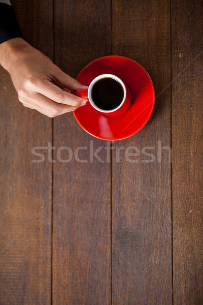 Woman holding a cup of coffee Stock photo © wavebreak_media