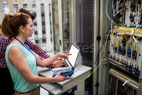 Technicians using laptop while analyzing server Stock photo © wavebreak_media