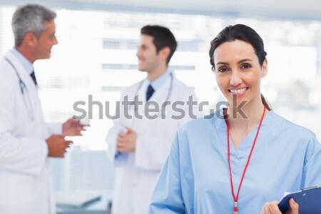 Portret mannelijke artsen verpleegkundige permanente gang Stockfoto © wavebreak_media