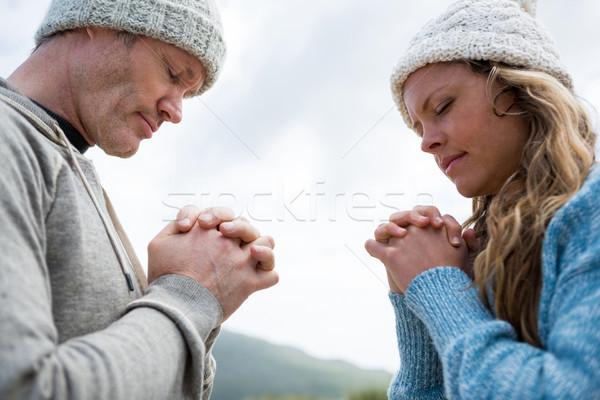 Couple praying with hands clasped Stock photo © wavebreak_media