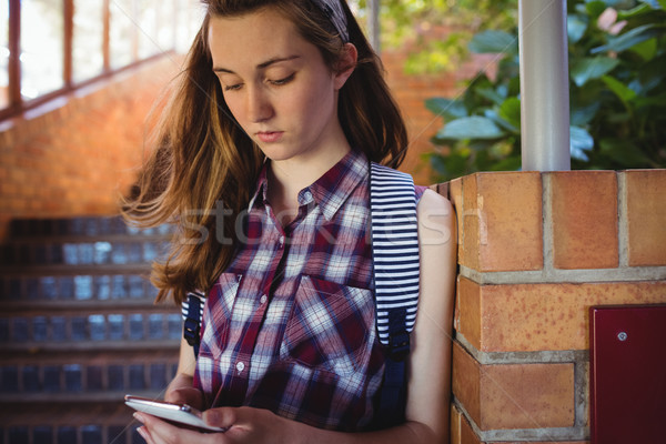 внимательный школьница мобильного телефона лестница школы интернет Сток-фото © wavebreak_media