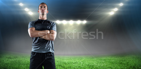 Composite image of full length of confident rugby player with arms crossed Stock photo © wavebreak_media