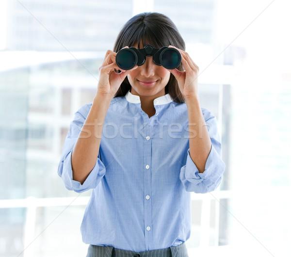 Assertive female executive looking through binoculars Stock photo © wavebreak_media