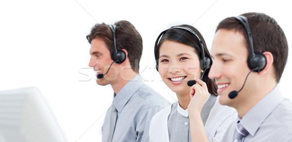 Assertive customer service agents working in a call center Stock photo © wavebreak_media