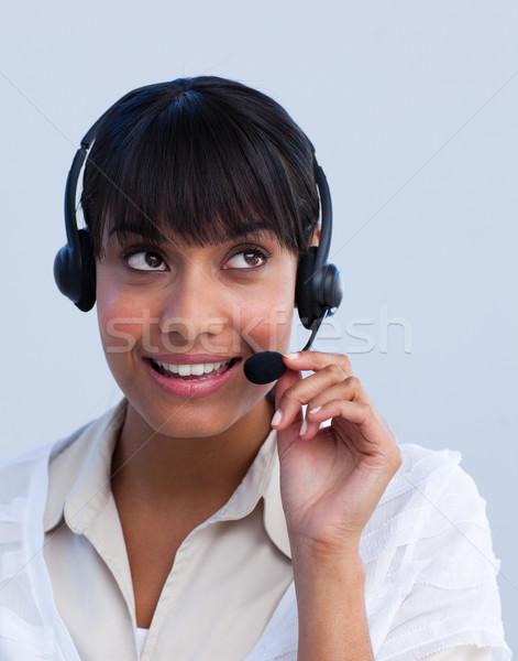 Attractive ethnic businesswoman working in a call center Stock photo © wavebreak_media