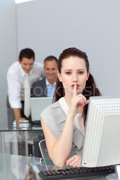 Charming businesswoman asking for silence  Stock photo © wavebreak_media