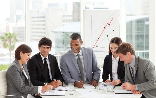 бизнес-команды сидят вокруг конференции таблице Сток-фото © wavebreak_media