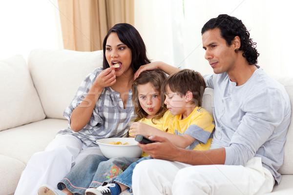Lively family watching TV on sofa Stock photo © wavebreak_media