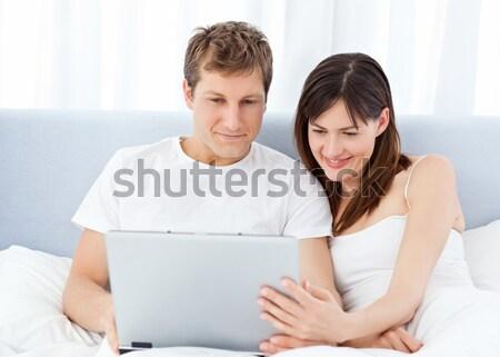Romantic couple reading a newspaper and drinking coffee  Stock photo © wavebreak_media