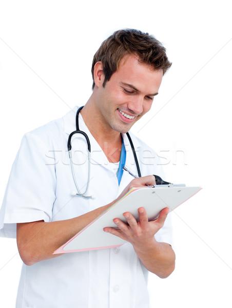 Attractive surgeon writting a report Stock photo © wavebreak_media