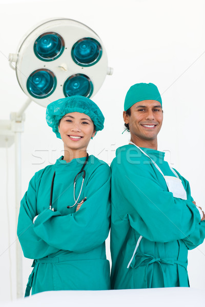 Two doctors wearing surgical gown Stock photo © wavebreak_media