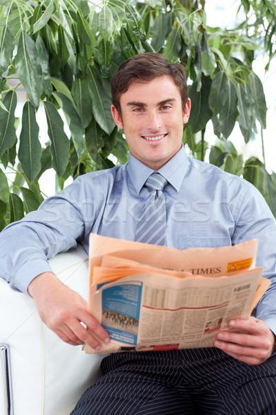 Handsome businessman reading a newspaper Stock photo © wavebreak_media