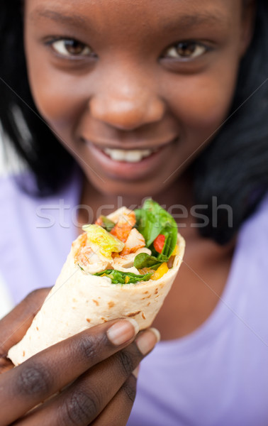 Attractive woman eating a wrap Stock photo © wavebreak_media