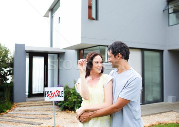Happy couple after buying house Stock photo © wavebreak_media