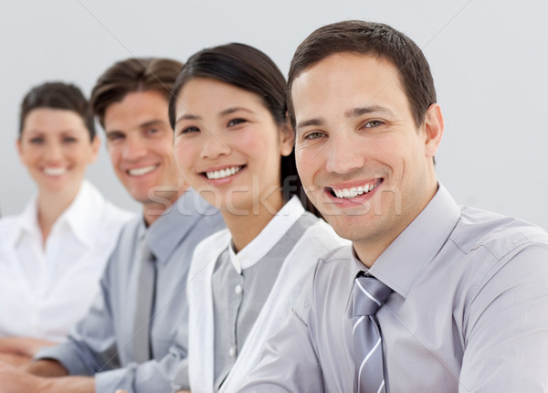 Young business people sitting in a line Stock photo © wavebreak_media