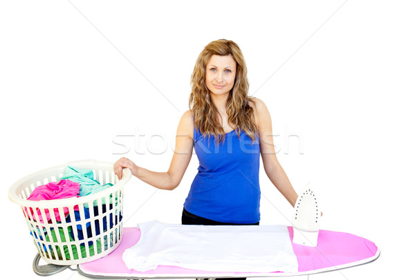 Unhappy woman with clothes behind ironing board against white background Stock photo © wavebreak_media