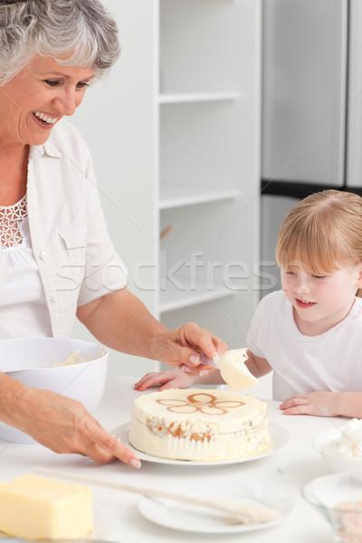Lány sütés nagymama otthon ház mosoly Stock fotó © wavebreak_media