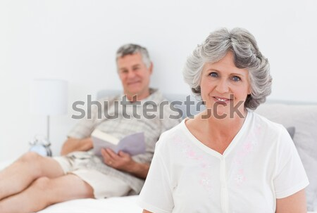 Emeryturę pacjenta pielęgniarki patrząc kamery rodziny Zdjęcia stock © wavebreak_media