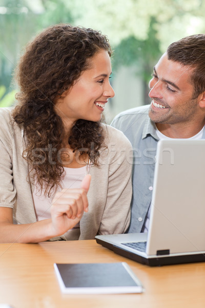 Lovers looking at their laptop at home Stock photo © wavebreak_media