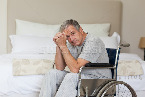 Thoughtful senior man in his wheelchair  at home Stock photo © wavebreak_media