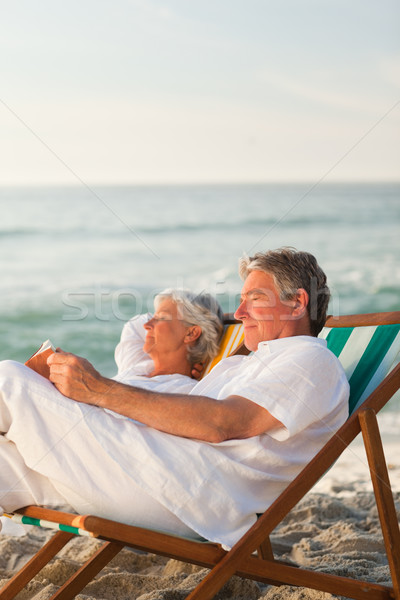 Man reading a book while his wife is sleeping Stock photo © wavebreak_media