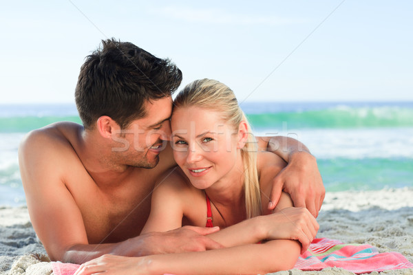 Lovers lying down on the beach Stock photo © wavebreak_media