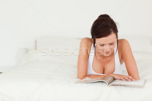 Portrait of a woman reading a magazine in her bedroom Stock photo © wavebreak_media