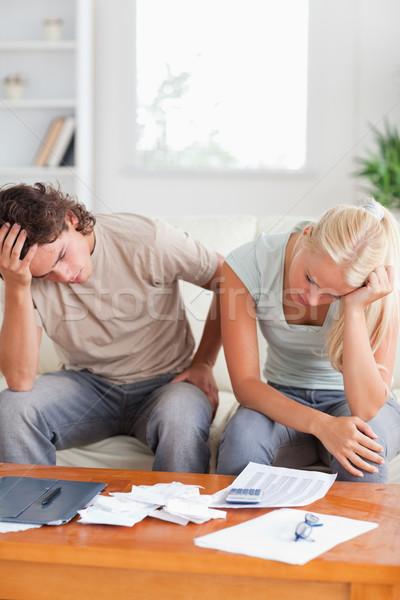 Unhappy couple on a sofa in the living room Stock photo © wavebreak_media