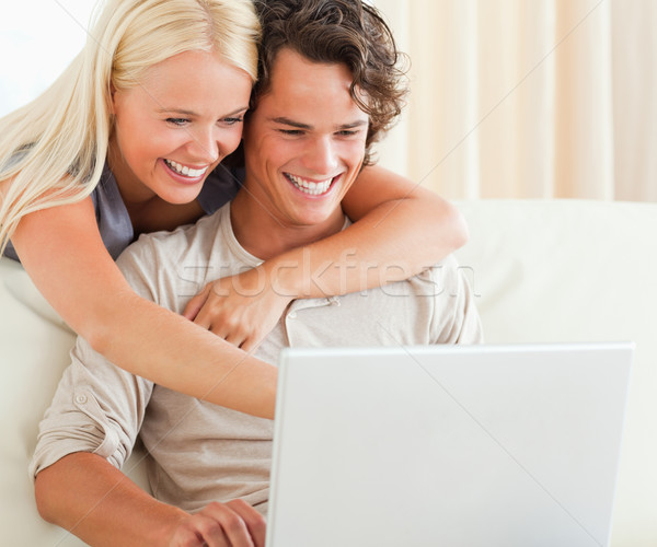 Couple using a laptop in their living room Stock photo © wavebreak_media