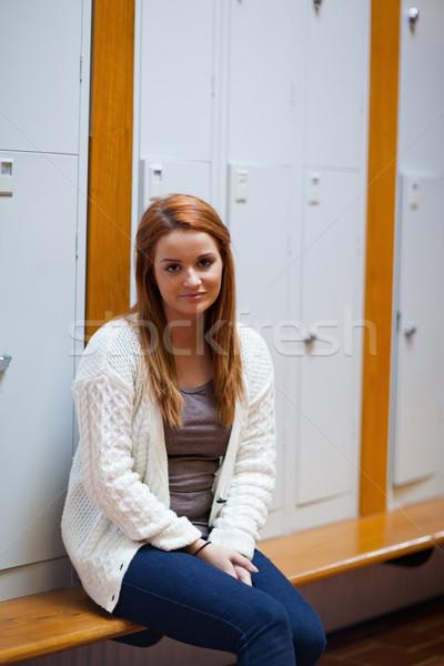 Portret zmęczony student posiedzenia ławce korytarz Zdjęcia stock © wavebreak_media