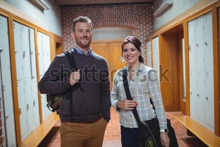Przystojny studentów stwarzające korytarz człowiek szkoły Zdjęcia stock © wavebreak_media