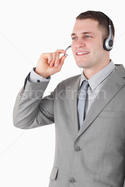 Stock photo: Portrait of a young operator using a headset against a white background