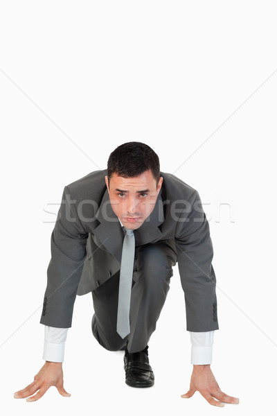 Portrait of a businessman in the starting blocs against a white background Stock photo © wavebreak_media
