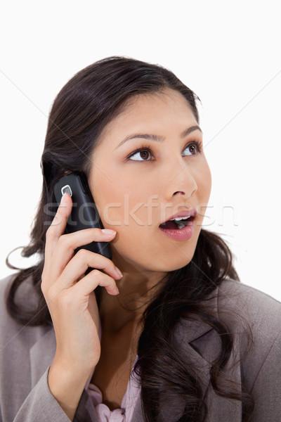 Zdziwiony telefonu kobieta biały telefonu telefon tle Zdjęcia stock © wavebreak_media