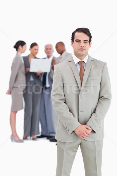Confident businessman with team behind him against a white background Stock photo © wavebreak_media