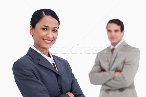 Smiling saleswoman with colleague behind her against a white background Stock photo © wavebreak_media