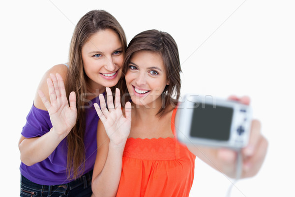 Tinédzserek integet digitális fényképezőgép boldog szépség kép Stock fotó © wavebreak_media