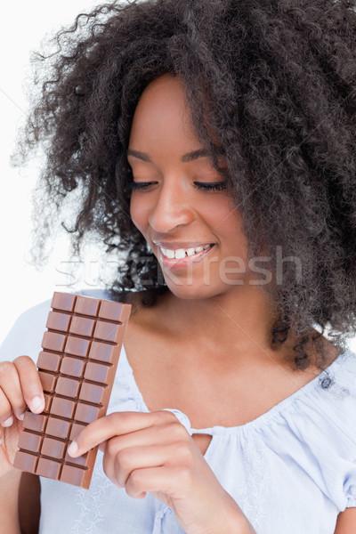 Genç kadın bakıyor lezzetli çikolata beyaz el Stok fotoğraf © wavebreak_media