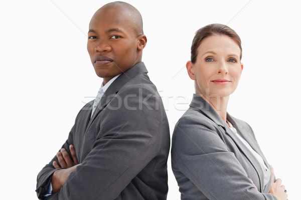 деловые люди рук глядя камеры заседание счастливым Сток-фото © wavebreak_media