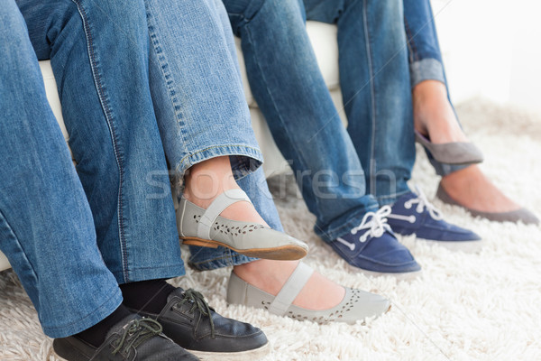 A side view of four pairs of feet and legs  Stock photo © wavebreak_media