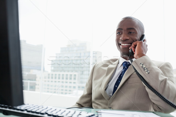 Smiling businessman on the phone in his office Stock photo © wavebreak_media