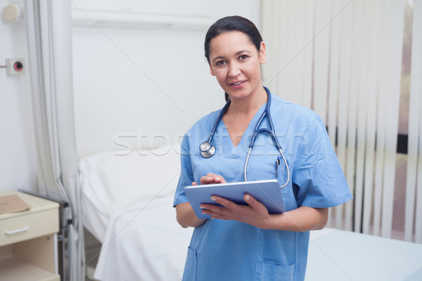 Nurse using a tablet pc in hospital ward Stock photo © wavebreak_media