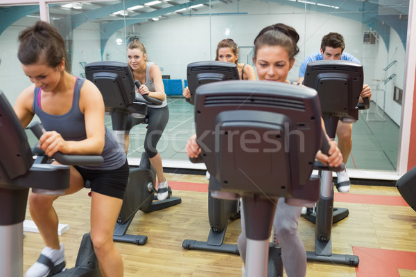 Spinning class in action in gym Stock photo © wavebreak_media