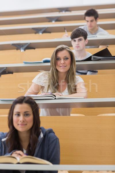 Studentów posiedzenia uśmiechnięty wykład sali inny Zdjęcia stock © wavebreak_media